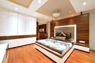 BEDROOM WITH WOODEN TOUCH TO IT