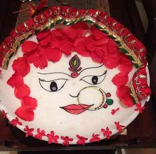 Navratri decor with red petals and chunni
