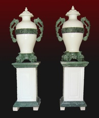 Marble vase pair with green marble handles and base stone