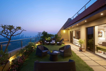 The terrace garden wears a serene look and comes alive with imaginative lighting.
