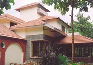 Traditional, vernacular sloping roofs with mangalore tiles