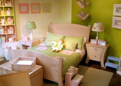 kids room beige wooden bed with green bedding bed combined by white table-lamp.