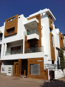 Building exteriors in white and wood finish