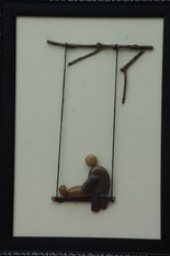 Natural Pebble Stone Art – A Mother with her Baby on Swing