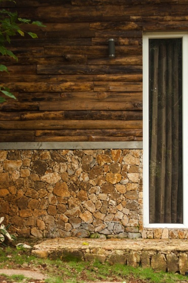 Exterior wall cladding with stone and wooden planks