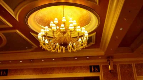 i like the ceiling alcove more than this piece of chandelier! state-of-the-art design.. really!