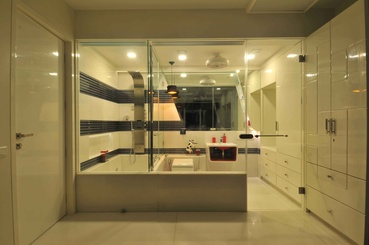 The Master Bathroom flanked with Glass