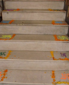 Simple rangoli created by 7 year olds on staircase steps