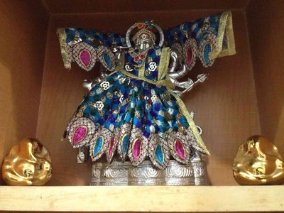 Traditional cloths put up on silver coated, Durga Maa!!