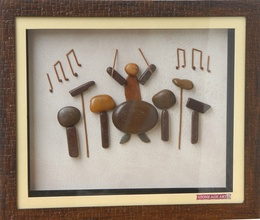 Musician with Drums – Natural Pebble Stone Art