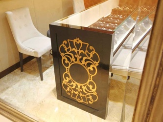 Display table with golden decorative work