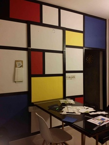 Office workspace wall art with architectural golden rectangles and squares. The table folds on to a frame that camouflages with the black lines used on the rest of the wall.