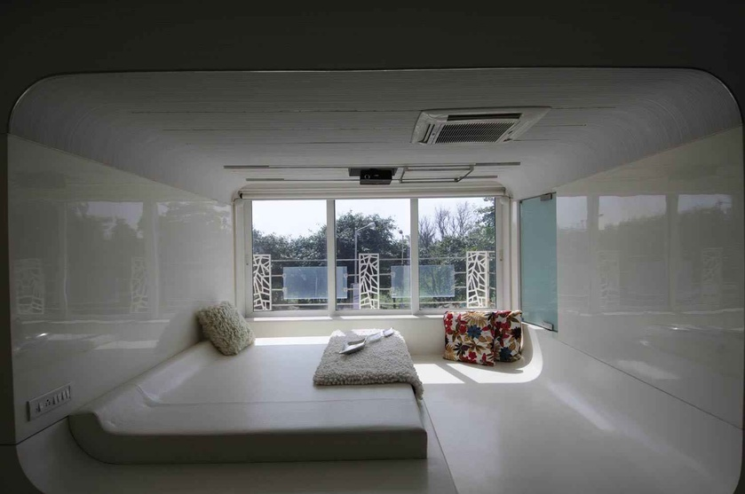 Modern White Bedroom with low raised bed