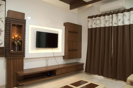 the tv unit designed in the bedroom