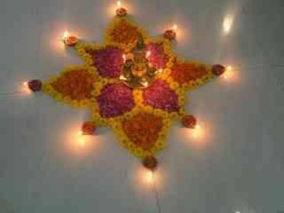 Flower Rangoli Design with Diyas.