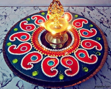 Navratri decor is generally completed with a kundan rangoli at the foot of the steps.