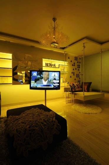 Living room with TV Unit in Yellow Light