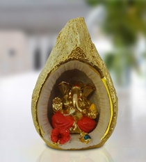 Buy Ganesha Inside Golden Nariyal