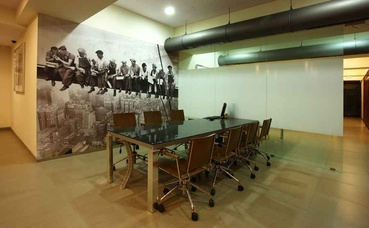 Conference Table in front of Large Wall Art