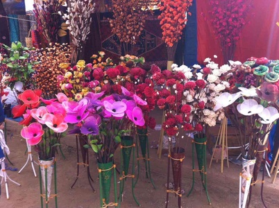 Artificial flower sticks in all possible hues of reds and pinks