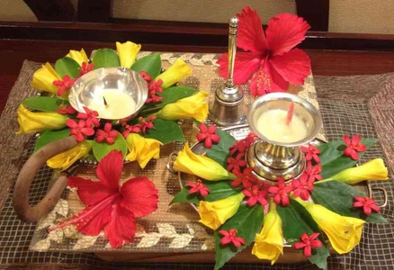Puja Thali With Diyas Decorated With Flowers.
