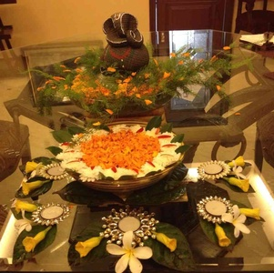 Diwali dinner table decorations with flowers and decorative T-lights
