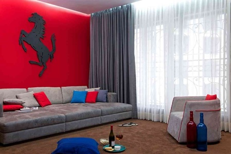 "The Home Theater Room is styled in a very inviting ""Lounge"" style with Acoustically related Bold Red Wall accentuated against the Neutral Grey wrap, keeping the Flavor Young and Vibrant."