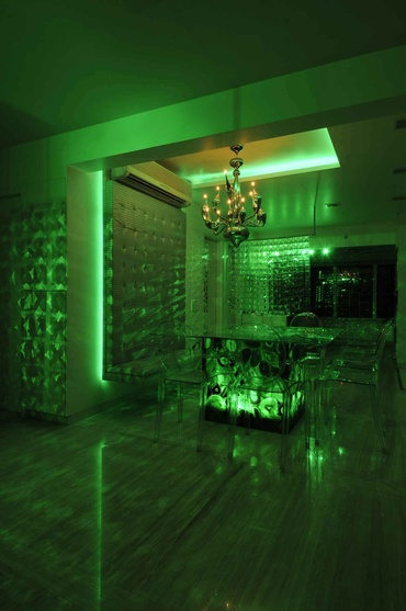 Modern Dining Area in Green Light