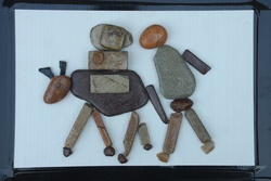 Natural Pebble Stone Art – a Man with Donkey