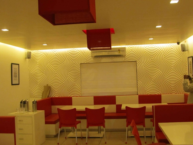 Wall design and bright seating used in the ResTAURANT