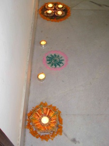Rangoli and diyas along the wall liven up the passage