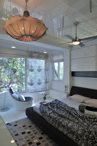 Black ad White Bedroom with tall Glass Windows