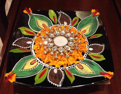 Rangoli with colors and marigold petals in a bowl...Diwali dinner decorations!