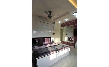 White and Maroon Bedroom in the Daylight