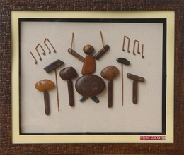 A Musician – Natural Pebble Stone Art
