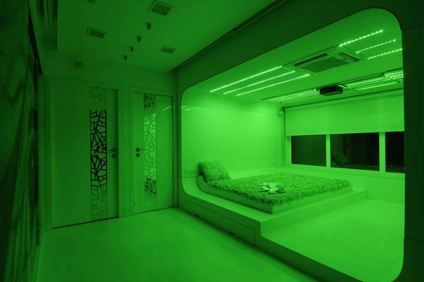 Modern white bedroom in green light